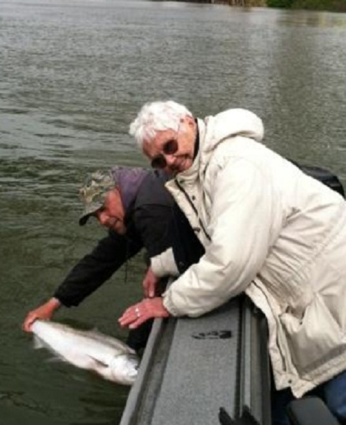 Donna celebrating her 82nd birthday with a Willamette River spring chinook - April 2012